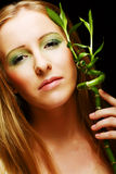 Woman with bamboo Royalty Free Stock Photo