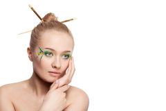 Woman with bamboo leaves style makeup Stock Photography