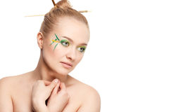 Woman with bamboo leaves style makeup Royalty Free Stock Image