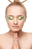 Woman with bamboo leaves style makeup Stock Image