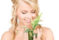 Woman with bamboo Royalty Free Stock Images