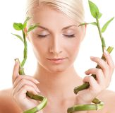 Woman with bamboo plant Stock Image