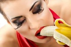 Woman with banana Royalty Free Stock Image