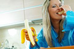 Woman with banana. Young blond woman with banana Stock Photo