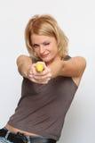 Woman and banana gun Stock Images