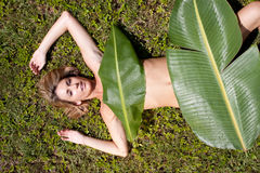 Woman in banana leaves Royalty Free Stock Photos