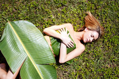 Woman in banana leaves Stock Photography