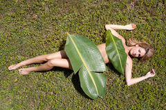 Woman in banana leaves Stock Images