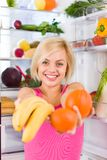 Woman banana orange refrigerator Stock Image