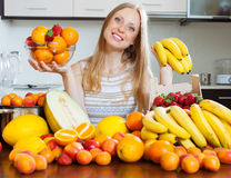 Woman with bananas and other fruits in home kitchen Royalty Free Stock Images