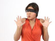 Woman  with band saying no gesture. Young chubby woman sitting on chair with black band tied to her eyes Stock Photos