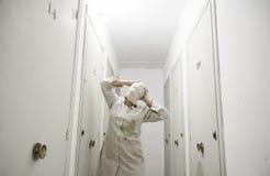 Woman bandaged storage Stock Images