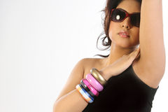 Woman with  bangles and sun glasses Stock Image