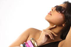 Woman with  bangles and sun glasses Royalty Free Stock Images