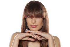 Woman with bangs. Young woman with bangs posing on a white background stock photo