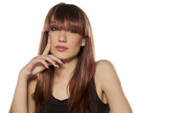Woman with bangs. Young woman with bangs posing on a white background royalty free stock image