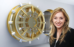 Woman and bank. Smilinmg woman and vault background Stock Image