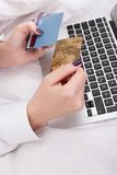 Woman banking or shopping online Stock Image
