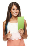 Woman with banner. Closeup of young woman holding a green banner ad and gesturing thumb up, over white background Royalty Free Stock Photo