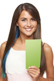 Woman with banner. Closeup of young woman holding a green banner ad over white background Stock Images