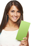 Woman with banner. Closeup of young woman holding a green banner ad over white background Stock Photos