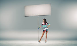 Woman with banner Stock Images