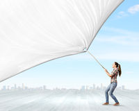Woman with banner Royalty Free Stock Images