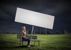 Woman with banner Stock Image