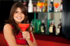 Woman at the bar Stock Photography