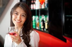 Woman at the bar Stock Images