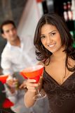 Woman at a bar Royalty Free Stock Images