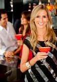 Woman in a bar Royalty Free Stock Photography