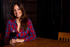 Woman in a bar Stock Photography