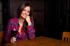 Woman in a bar Royalty Free Stock Image