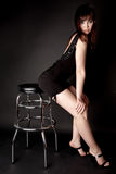 Woman on a bar chair Royalty Free Stock Photo