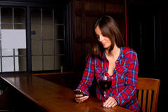 Woman in a bar Royalty Free Stock Images