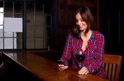 Woman in a bar Royalty Free Stock Photos
