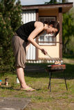 Woman and barbecue Royalty Free Stock Images
