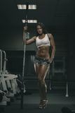 Woman with barbell Stock Images