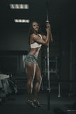 Woman with barbell Royalty Free Stock Images