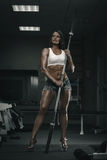 Woman with barbell Stock Image
