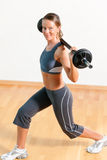Woman with barbell in gym Royalty Free Stock Photography