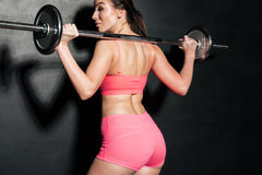 Woman with barbell training isolated Royalty Free Stock Photos