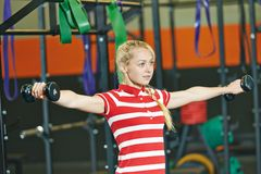 Woman with barbells in fitness gym Stock Photos