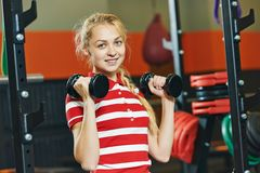 Woman with barbells in fitness gym Royalty Free Stock Photography