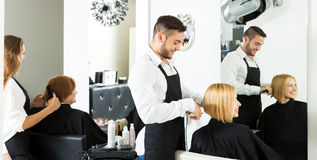 Woman in the barbershop Stock Images