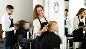 Woman in the barbershop Royalty Free Stock Image