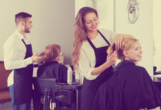Woman in the barbershop Stock Image