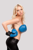 A woman with a bare chest with boxing gloves Stock Photography