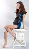 Woman With Bare Legs on Wicker Table royalty free stock photo
